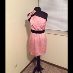BCBG Generation Cocktail dress Blush pink one shoulder dress with black straps and waist band. A line fit bottom with lining. Back has cris cross accent with straps. Very cute and flirty. Great for any occasion! Worn once. In excellent condition. No snags,holes, runs, or rips. BCBGeneration Dresses