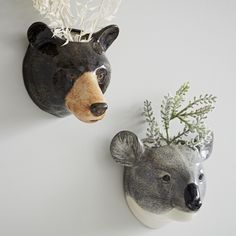 Quirky ceramic bear head wall vases for plants, flowers or anything you like - kitchen utensils or even pens and pencils.  Available as a brown bear or koala these make an unusual and adorable gift.