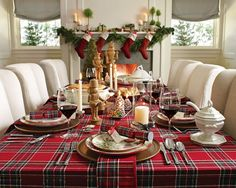 plaid with white chairs showcase this lovely Christmas table, fabulous mantel in the background too!