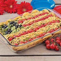 Patriotic Taco Salad. I am replacing meat with refried beans so can be served cold. Also, use mozzarella cheese instead of cheddar so it's white.