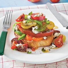 Texas Toast Tomato Sandwich Recipe | Make a meal of Texas Toast by topping it with heirloom tomatoes, fresh basil, and blue cheese vinaigrette. | SouthernLiving.com