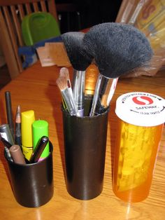 This industrious DIYer used bronze spray paint to transform medicine bottles into cup holders for brushes.�These will require a few additional magnets.�