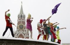 Members of the Russian radical feminist group Pussy Riot sing a song at the so-called Lobnoye Mesto (Forehead Place), long before used for announcing Russian czars' decrees and occasionally for carrying out public executions, in Red Square in Moscow on Jan. 20. Eight activists, who were later detained by police, staged a performance to protest against policies conducted by Prime Minister Vladimir Putin.