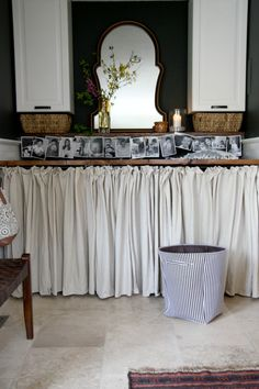 I love the idea of hiding the washer and dryer behind a pretty curtain. This would work great  when the laundry room is also a bathroom. Everything is there, right where you need it, but dressed up and camouflaged.