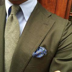 Olive blazer w/ matching knit necktie, sky dress shirt, & blue/greyscale print kerchief ~ Viola Milano