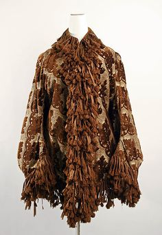 Dolman (1883-1889)... ok, so this is cool fabric, but the fringe! it's really odd looking.