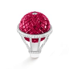 - Montgolfière Mystérieuse ring, Les Voyages Extraordinaires™ collection -  White gold, Mystery Set rubies and diamonds. The Montgolfière Mystérieuse ring fromLes Voyages Extraordinaires™ collection, inspired by Jules Verne's novel: Five weeks in a balloon, depicts an extraordinary feat in jewelry: a unique three-dimensional form of MysterySetting™.