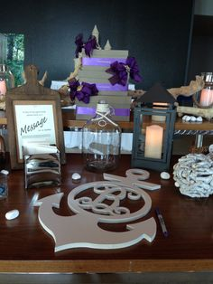 """Personalized anchor as a guestbook with a purple beach theme and a creative """"message in a bottle"""" activity for the bride and groom to read on their first anniversary at One Atlantic - Atlantic City, NJ #wedding #cocktailhour #cardbox #beach #theme #guestbook #diy #oneatlanticevents #atlanticcity #njweddings www.oneatlanticevents.com www.facebook.com/oneatlanticevents"""