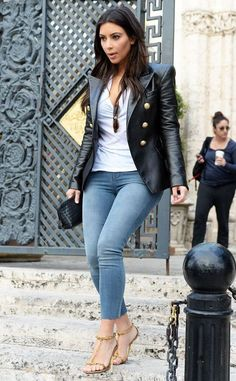Kim Kardashian street style with leather jacket, white T-shirt and skinny jeans. #kimkardashian