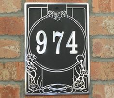 House address plaque with your house number in the Art Nouveau Style. Solid Aluminium hand made to order in England.