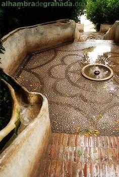 Alhambra de Granada Spain  water going down brick steps to fountain pool