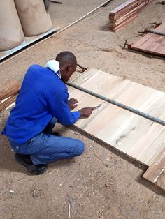 8. After routing F joint profiles into the length edges of panel and table top planks they move to 'glue ups' where they are laid in sequence, glued and clamped to become more recognisable as the final components they will be.