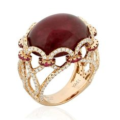 Tomo 18k rose gold ring featuring 21.18 carat rubellite and 0.51 carat ruby. accented with 1.48 carats of ideal cut diamonds