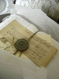 Antique music bundles w/ twine and sealing wax