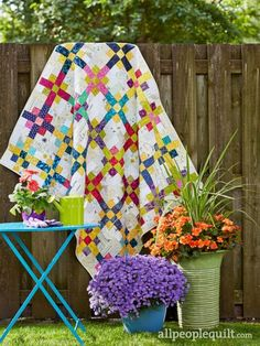 Vivid Grid by Sharon McConnell in Quilts and More Spring 2017 issue.