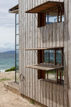 Sled house is clad in timber boards which will eventually grey to match the surrounding landscape. Whangapoua by Crosson Clarke Carnachan Architects (via Lunchbox Architect)