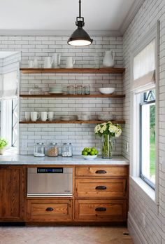 wood shelving + white subway tile + marble counter