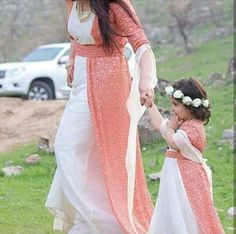 Kurdish mother and daughter in beautiful traditional dresses.