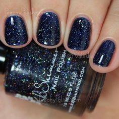 "KBShimmer ""Carpe Denim"" has a deep navy jelly base that's super dark but not too dark that it appears black and it's packed with holographic silver glitter and shimmer."