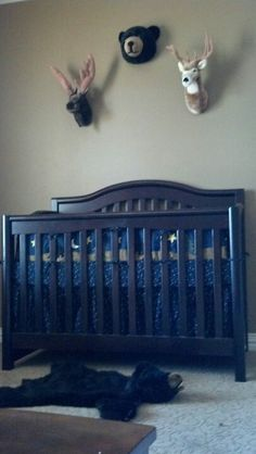 More of a forest green paint, more elaborate crib, wood floors, and some windows to break up the dark colors.