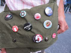 Busy Beaver Button-O-Matic Party 2013 - A button fan shows off his bag.