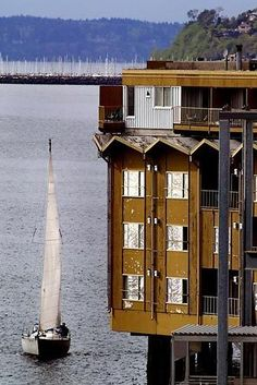A sailboat checks out the Edgewater Inn as it cruises the edge of Elliott Bay in Seattle