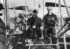 Siblings Orville Wright, Katharine Wright, and Wilbur Wright at Pau, France. Miss Wright about to be taken for her first ride in an airplane. February 15, 1909