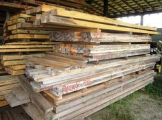 """My favorite store - a visit to a real lumber yard - rough cut pecky cypress 2x4s stacked on the bottom.  See the gray looking boards with the date & product name painted in red on the edges.  The rough cut thick boards on the top (3"""" to 4+"""" thick) are for fireplace mantles and main beams for support in building houses with exposed cypress wood showing.  I use these beams for tops of bars, for custom supports for the foot rests for my bars and for table tops.  Some of these beams are also…"""