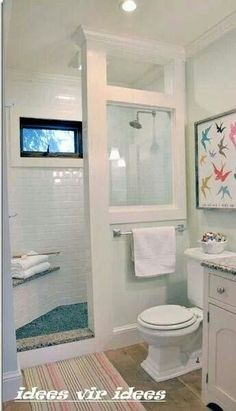 Small bathroom idea...put window on wall between tub and shower using rock work and rustic motiff