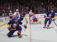 John Tavares With The Game Winning Goal In OT vs Washington. I love the looks on the Isles faces in this, and I kind of love that it captures Holtby looking to see where the puck went. Nhl Hockey Teams, Sports Teams, John Tavares, My Kind Of Love, New York Islanders, Washington Capitals, Football Helmets, Motorcycle Jacket, Basketball Court