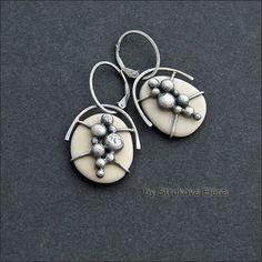 Earrings with pebbles ivory collection of stones, made of silver patinated metal surface matte. Flip lock design allows for smooth suspens ...