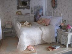 The bed spread is a vintage ladieshandkerchief the embroidery and lace are just perfect. The extra is just artfully stuffed down the side.