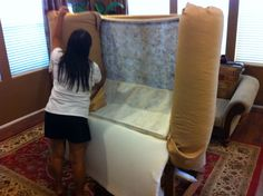 My wife helping with one of the arms of our inverted couch.