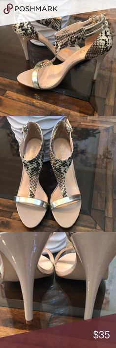 """Guess embossed snake print heel in silver! Such a pretty feminine heel!  Love the creams, black and brown mix in the snake print!  Heel measure at 4"""".  Good condition, worn a couple of times!  Great with jeans and a cool jacket!! Guess Shoes Heels"""