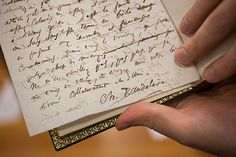 A volume by French poet Charles Baudelaire contains handwritten letters signed by Baudelaire.