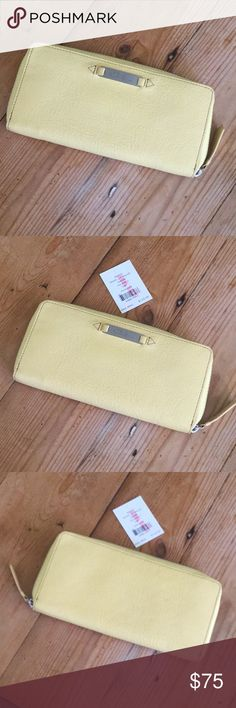 """Cole Haan NWT Yellow Leather ZIp Around Wallet NWT Lemon Yellow zip around Wallet in perfect shape, no issues, beautiful.  Approx.  8"""" long, 4"""" wide, 1"""" deep.  Happy to answer questions, thanks !❤️ Cole Haan Bags Wallets"""