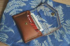 Stitched with waxed thread. Made of genuine cow leather made in Russia. Wallet holds up to twelve cards and 15-30 bills. All made by hand, no machines.