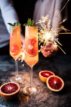 Go ahead, replicate this photo entirely come your New Year's Eve wedding, from the blood orange sparkling mule (made with Champagne, blood orange juice, ginger beer, vodka, and mint) to the festive sparklers.