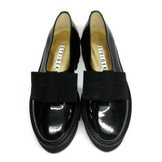 Fantastic Walter Steiger 40mm smoking bow black patent leather loafers. Slip on. Front elastic insert. Grosgrain bow on upper. Stitched welt. Treaded micro vibram rubber sole.Size: 36.Leather lining.Made in Italy.