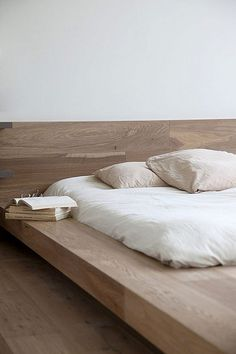 Bed, pillows, mattress, wood, books