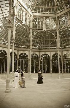 Victorian ladies inside the Crystal Palace. The Crystal Palace is a metal and glass structure located in the Jardines del Retiro in Madrid (Spain). It was built in 1887 for the Exposition of the Philippines, held that year. It was inspired by the Crystal Palace, Paxton (U.K.). by TamidP