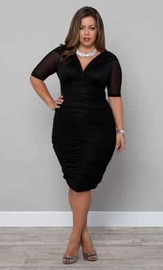 You can never go wrong in a classic black dress.  We LOVE the curve hugging fit on the Betsey Ruched Dressy by Kiyonna as modeled here by the gorgeous Fluvia. #plussize #kiyonna