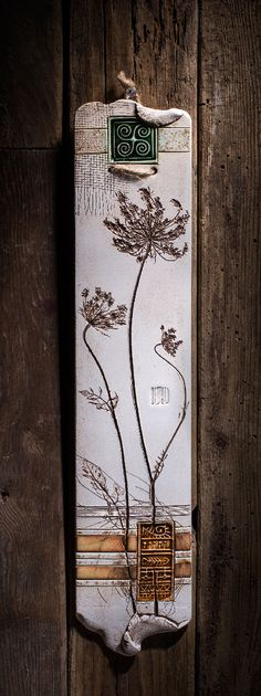 "Botanical pieces have been pressed into the wet clay to create the elegant look of those wall plaques.Varied textures and vibrant colors make them an exquisite piece of the home decor ( W 3"" x H 14"" )"