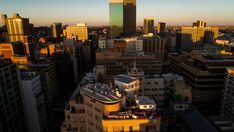 Stock Footage of A sunset timelapse of the city centre of Johannesburg (CBD) with blue skies and shadows moving across showing the High Court of South Africa, old Sun International and Carlton Tower. Explore similar videos at Adobe Stock Seattle Skyline, New York Skyline, City Scene, Blue Skies, Stock Video, High Quality Images, Stock Footage, San Francisco Skyline, Shadows