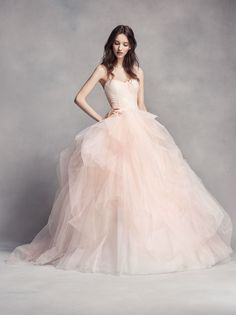 c97104a90e4 Pretty in pink wedding dress. This WHITE by Vera Wang strapless sweetheart  neckline ball gown