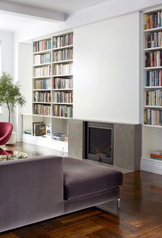 A sliding wall above the fireplace (a ventless model from Hearth Cabinet) conceals the television.