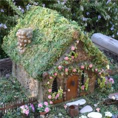 This house is made of concrete and stone to last for years to come, ideal for outdoor use. Vines with miniature clay roses climb the branch trellis. A tiny pine cone adorns the front door. One of the prettiest fairy cottages I've ever seen!  ********************************************  Enchanted Gardens via Etsy - #fairy #garden #gardens #miniature #miniatures #fairies #whimsical #whimsy #house - tå√
