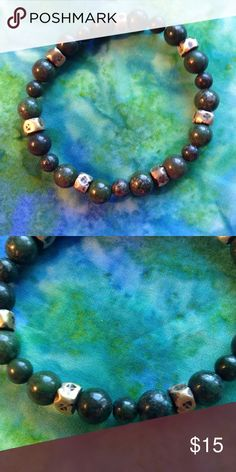 Green copper lapis lazuli bracelet This bracelet is made with genuine green copper lapis lazuli stones. I've never come across these before. The brass spacers Nigerian. If you want unusual, here it is. Jewelry Bracelets