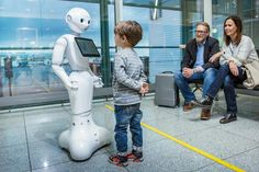 Humanoid robot Josie Pepper answers questions at Munich Airport. — AFP