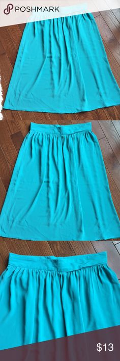 Light Turquoise Skirt Sized as a size 18 but waist measures 36 inches. More suited for size 14. Tucking around entire waist to give more fullness, zips up back with 2 buttons, measures 30 inches long, super lightweight with lots of flow with movement. diversity Skirts A-Line or Full